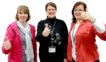 Three women in collaboration with thumbs up